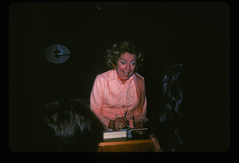 Christine Jorgensen, the first person widely known to have sex reassignment surgery, signs her biography after speaking at ONE Incorporated. March 9, 1975.