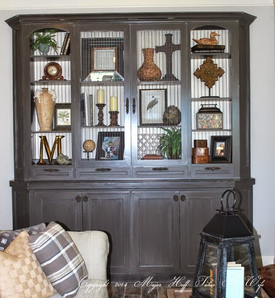 Custom built in living room cabinet with arched doors