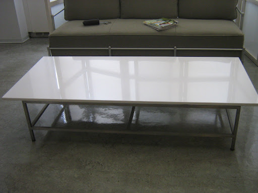 Here it is, polished and ready to be moved into my apartment. The top is white glass and the legs are metal.