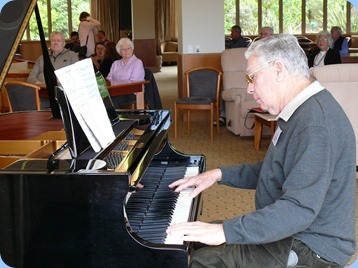 JIm Nicholson playing the grand piano. Photo courtesy of Dennis Lyons.