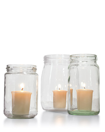 With a candle placed inside these glass jars, the lighting looks eclectic and interesting. They'd look fabulous on your outdoor bar or tablescape. (marthastewart.com)
