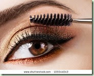 stock-photo-woman-applying-mascara-on-her-eyelashes-105544043