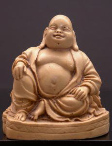 Laughing Budha: Chinese Ch'an (Zen) monk who lived over 1,000 years ago and has become a significant part of Buddhist and Shinto culture