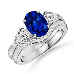 Oval Sapphire and Diamond Three Stone Ring