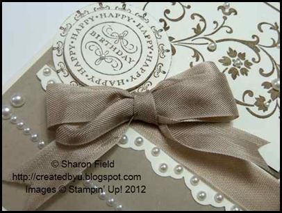 pretty double loop bow and pearls along eyelet border punched edge