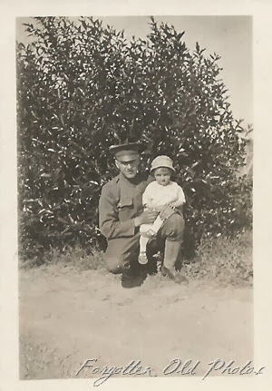 WW1 Soldier and a child Royalton Antiques