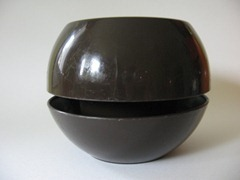 brown plastic planter by Phillips Products Co., Inc.