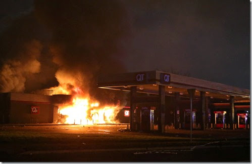 The QuikTrip in 9400 block of W. Florissant Avenue in Ferguson, Mo. burns after being looted by rioters on Sunday, Aug. 10, 2014.  The riots were sparked after community protests over a fatal officer involved shooting in Ferguson the day before.