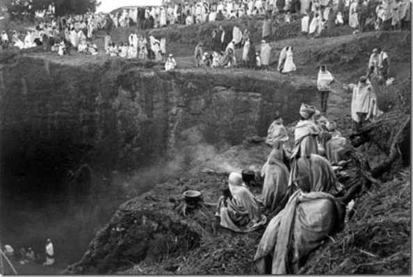 Pilgrims cooking beans during Christmas worship in the campground around Bet Madhane rock-hewn church. The basic food, always present in Amharic and Tigray people, is the INJERA made by grain called teff, cultivate in highlands.