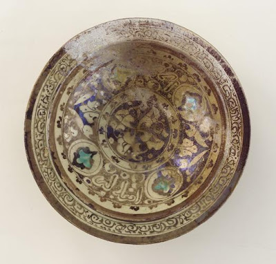 Bowl | Origin:  Syria | Period: 12th-13th century  Ayyubid period | Details:  Not Available | Type: Stone-paste painted under clear-glaze | Size: H: 7.5  W: 25.9  cm | Museum Code: F1942.5 | Photograph and description taken from Freer and the Sackler (Smithsonian) Museums.