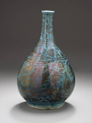 Wine Bottle Iran Wine Bottle, second half of the 17th century Ceramic; Vessel, Fritware, overglaze luster-painted, 8 7/16 x 5 1/16 in. (21.4 x 12.9 cm) The Nasli M. Heeramaneck Collection, gift of Joan Palevsky (M.73.5.196) Art of the Middle East: Islamic Department.