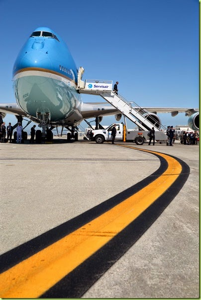 "July 23, 2014 ""Occasionally, a graphic element becomes the key factor in an interesting photograph. Here, at Los Angeles International Airport, I ran out in front of Air Force One to preposition myself at a low angle to take advantage of the yellow stripe as the President walked off the plane."" (Official White House Photo by Pete Souza)"