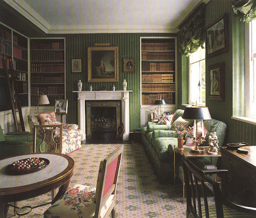 This library's covered walls, in a green velour de lin, works so well with the Buxted carpet, damask upholstery and hints of floral.