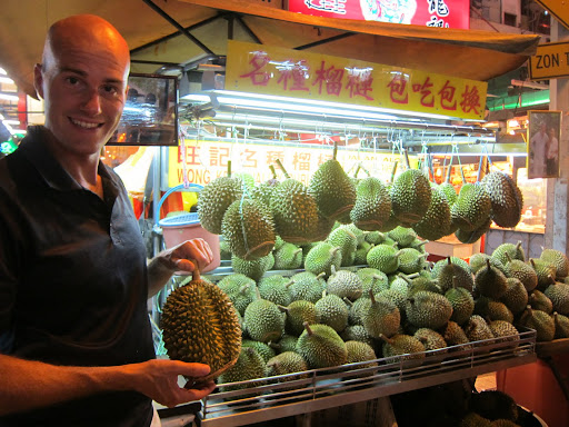Erik with a durian fruit.