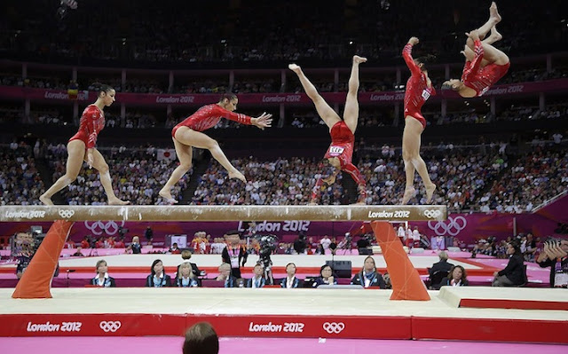 In this multiple exposure photo, U.S. gymnast Alexandra Raisman performs on the balance beam during the Artistic Gymnastics women's team final at the 2012 Summer Olympics, Tuesday, July 31, 2012, in London. (AP Photo/Julie Jacobson)