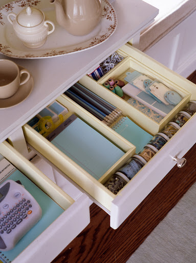 Supplies can be organized in an extra drawer. This one is designed to hold silverware.