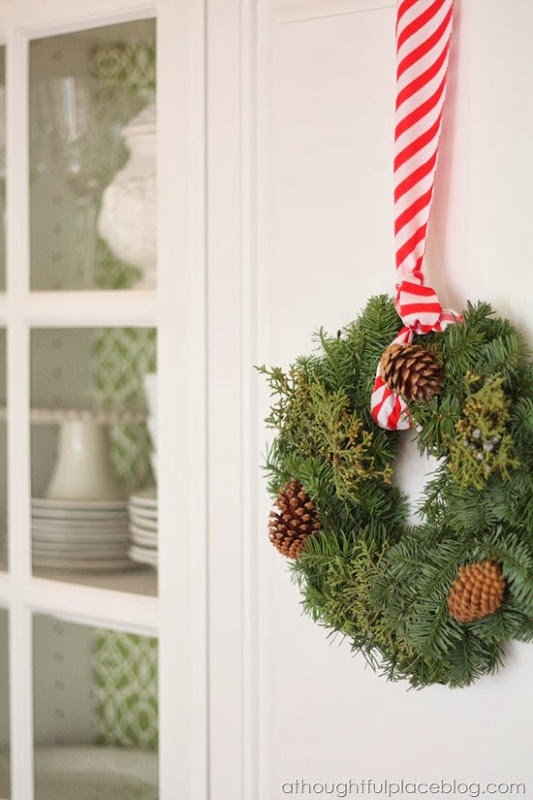 Five Ways to Decorate With Wreaths - A Thoughtful Place Under Kitchen Cabinets For Christmas Decorating on christmas decorating for windows, christmas decorating for kitchen countertops, christmas decorating for walls, christmas decorating for fireplaces, christmas decorating for dining room, christmas decorating office, christmas decorating for stairs, christmas decorating for light fixtures, christmas decorating for doors,
