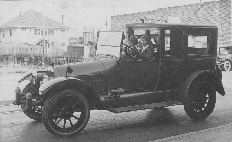 Dorothy Putnam (passenger seat) in the custom built Cadillac she drove for Director Will Davis. She was the first female chauffer in the country in 1918. 1919.