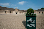 A very pristine looking stables, bathed in sunshine