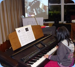 A special guest, Cindy Yang, playing two classical pieces beautifully on the Clavinova