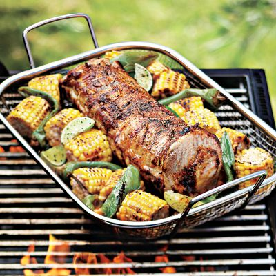 Grilling vegetables is tricky. Use a cooling rack or this wire basket with a grid pattern to grill smaller items that would normally slip through the grates. (williams-sonoma.com)