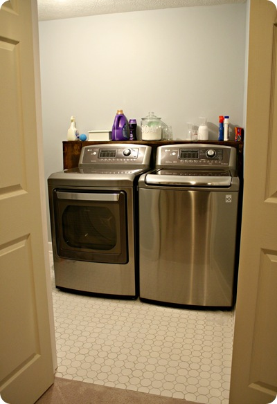 Diy laundry room storage from thrifty decor chick for Shelf above washer and dryer