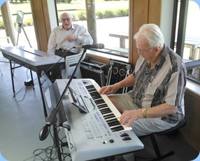 Peter Herrick playing the Yamaha Tyros 4 whilst Brian Teviotdale watches on with interest.
