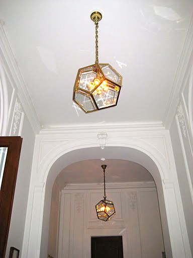 These light fixtures hang all around the gallery. They are so modern and elegant.