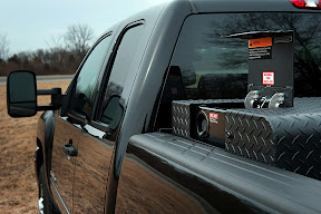 GM has added bi-fuel CNG-gasoline pickups to its natural gas vehicles range. The bi-fuel CNG Chevrolet Silverado and GMC Sierra 2500 HD extended cab pickup trucks will be available in both short bed and long bed models. They have 6.0-liter V-8 engines with gaseous-prep hardened valves and seats, and injectors by Bosch. A single Type III (aluminum liner and carbon composite overwrap) CNG cylinder will hold 17 gasoline gallon equivalents of CNG, allowing room in the truck bed for a robust protective cabinet. The fuel tank will be mounted to the frame itself, not the truck body. The bi-fuel vehicle will have a 36-gallon gasoline tank. (Photo by James Fassinger for Chevrolet)