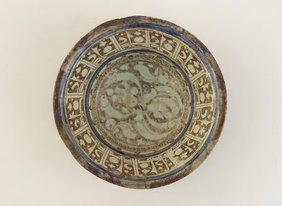 Bowl | Origin:  Syria | Period: 12th-13th century  Ayyubid period | Details:  Not Available | Type: Stone-paste decorated under glaze with blue and over glaze with brown lustre | Size: H: 10.5  W: 28.0  cm | Museum Code: F1908.148 | Photograph and description taken from Freer and the Sackler (Smithsonian) Museums.