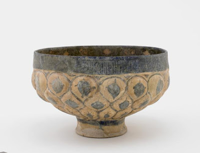 Footed bowl | Origin:  Kashan,  Iran | Period: 13th century  Saljuq period | Details:  Not Available | Type: Earthenware molded and painted with glaze | Size: H: 12.1  W: 19.5  cm | Museum Code: S1997.112 | Photograph and description taken from Freer and the Sackler (Smithsonian) Museums.