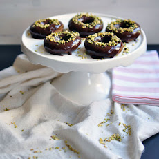 Baked Pumpkin Donuts with Chocolate Glaze and Chopped Pistachios