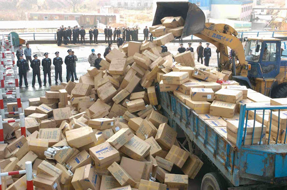 china-government-destroying-counterfeit-cigarettes.jpg