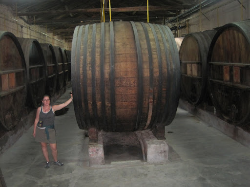Heather posing with some large antique casks at Bodega La Rural.