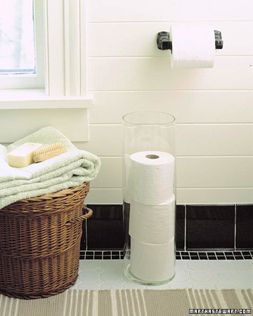 Take a clear umbrella stand and turn it into a tube to hold toiletpaper.