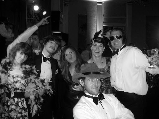Though plans to rent a photo-booth didn't ultimately pan out, props had been purchased already and guests took advantage of them for some additional fun on the dance floor following the cake-cutting.