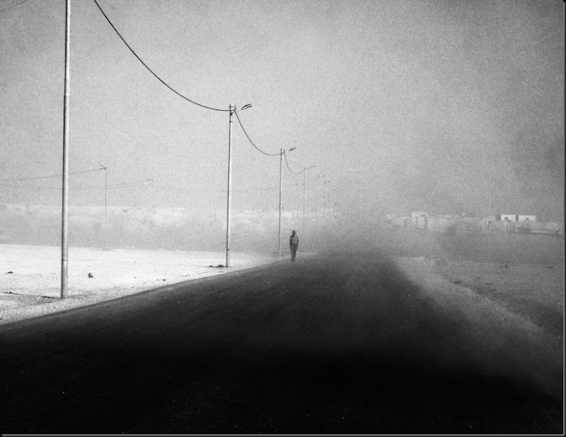 A man walks through a sandstorm on the edge of the Zaatari refugee camp in Jordan. (Moises Saman/Magnum Photos for Save the Children)