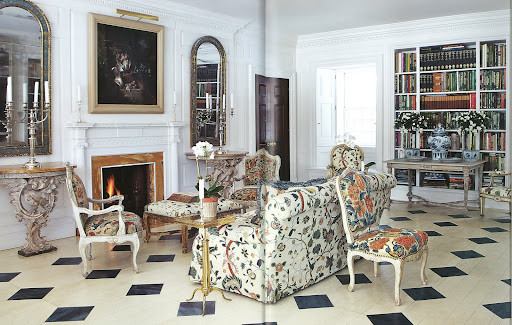 This bright room features English embroidery on the chairs and sofa, as well as painted furniture.