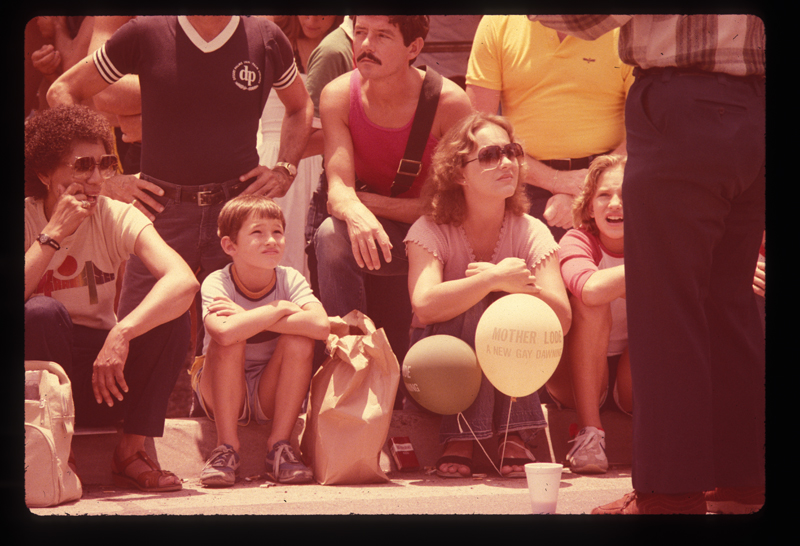Family watching the Los Angeles Christopher Street West pride parade. 1982.