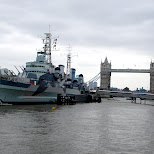 warship in front of the london tower bridge in London, London City of, United Kingdom