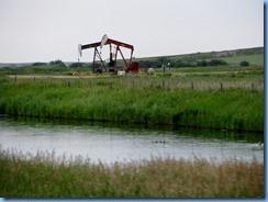 2010 Saskatchewan TC-1 East - two of many oil well pumps between Gull Lake & Webb