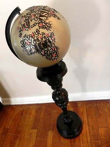 typographical art globe with upcycled pedestal