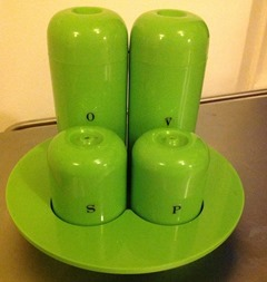 Lime green plastic cruet set for oil, vinegar, salt, and pepper