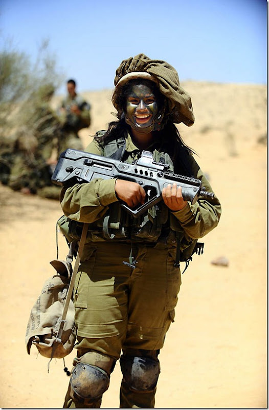 """""""Optimism"""". A soldier of the Caracal co-ed battalion during a platoon exercise in southern Israel, 2012."""