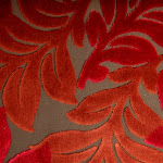 Tkanina obiciowa, trudnopalna. Pluszowa. Motyw roślinny - liście. Czerwona, brązowa.