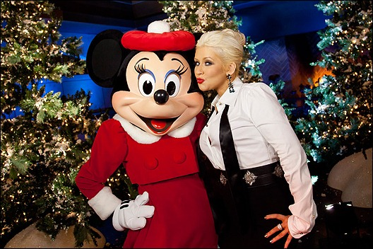 ANAHEIM, CA - NOVEMBER 06: In this handout photo provided by Disney Parks, Christina Aguilera poses with Minnie Mouse following the taping  of the 2011 Disney Parks Christmas Day Parade at Disney's Grand Californian Hotel & Spa  on November 06, 2011 in Anaheim, California. The performance airs on Christmas Day (December 25, 2011).(Photo by Paul Hiffmeyer/Disney Parks via Getty Images)