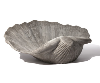 This unique scallop shell planter should be filled with flowers as beautiful as Aphrodite herself. (pennoyer.com)