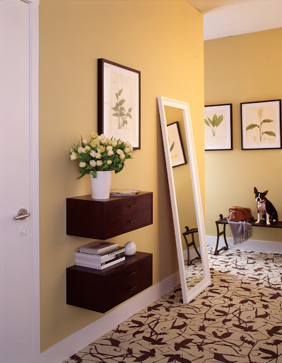 For a sleek entryway look, try installing floating drawers. And the bigger the mirror the better. Opt for a full-length mirror if you have the space.