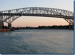 3715 Ontario Sarnia - Blue Water Bridge over St Clair River at sunset - Great Lakes Trader barge being pushed by the tug Joyce L. VanEnkevort
