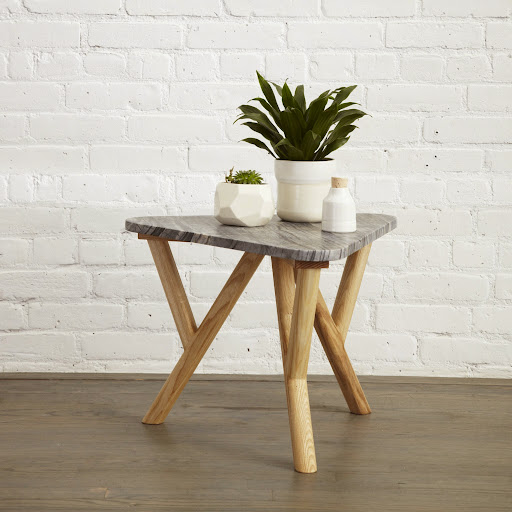 The end table is available in white, green, grey (shown), and black marble.